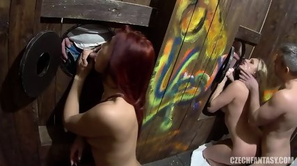 Couple Of Sluts Suck Cocks Throw Colorful Gloryholes