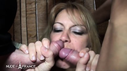 Blonde Slut Has Two Cocks Inside Her Mouth